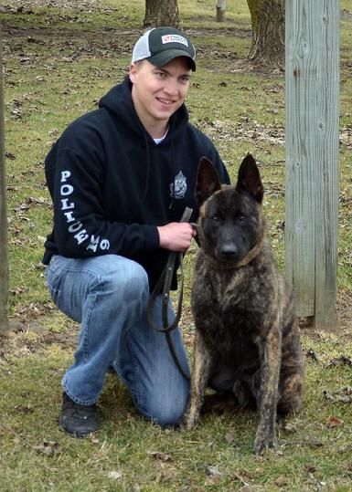 Orleans County Vermont Sheriff's Department Deputy Tyler Jacobs with his new PSD K9 Cher Car's Jonah