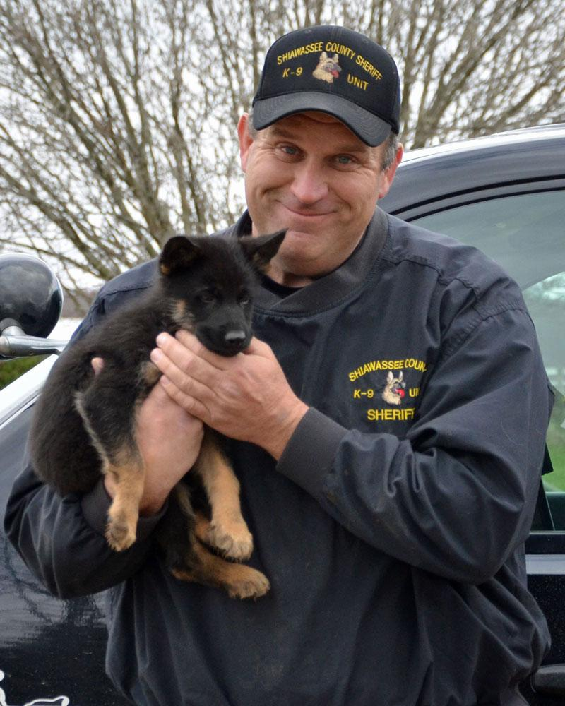 "Butch Brancheau of theShiawassee County Sheriff's Department in Corunna, Michigan with his future PSD K9 ""Vader"""