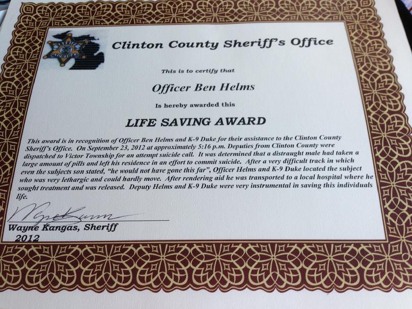 "St. Johns Police Service Dog ""Duke"" and handler Ben Helms earn Life Saving Award from Clinton County Sheriff's Office"
