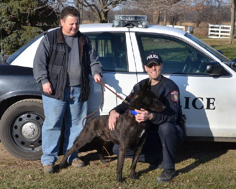 "Police Chief Matt Balsley and dual purpose PSD K9 CH Cher Car's Sir Reggie aka ""Reggie"" of the Morrice, Michigan Police Department with breeder/trainer Cheryl Carlson of Cher Car Kennels.  We are uncertain of how many Dutch Shepherd breed Champion Police Service Dogs there are, but suspect ""Reggie"" might be the first of his breed!"